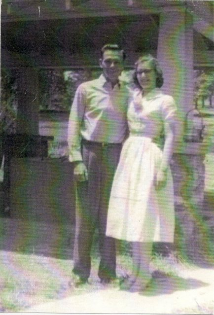 My grandparents outside their home Arkansas in 1957.